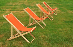 Chaise lounge. On a green grass stock photo