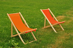 Chaise lounge. On a green grass stock image