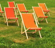 Chaise lounge. On a green grass royalty free stock photo