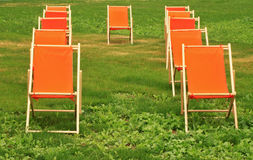 Chaise lounge. On a green grass royalty free stock images