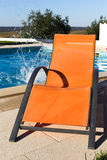 Chaise lounge - 01. Chaise lounge around swimming pool at a sunny day royalty free stock photos