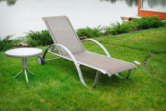 Chaise lounge on the banks of the river Royalty Free Stock Photo