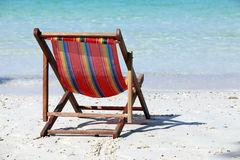 Chaise lounge on a beach Stock Image