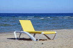 Chaise lounge on beach. Royalty Free Stock Photography