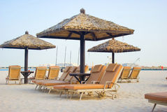 Chaise lounge on a beach. In Dubai royalty free stock photography