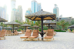 Chaise lounge on a beach. In Dubai royalty free stock photos