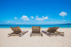 Chaise lounge on beach. Beautiful tropical sea beach with chaise lounge royalty free stock photography