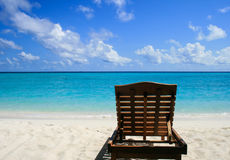 Chaise lounge on the beach Stock Images