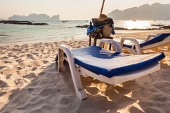 Chaise lounge on the beach. A plastic chaise lounge on a tropical beach on sunset in Phi Phi Island, Thailand stock photo