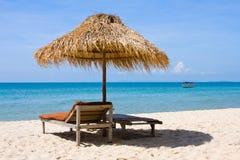 Chaise lounge on the beach , Thailand Stock Photos