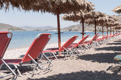 Chaise lounge chairs on beach Stock Image