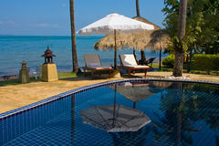 Chaise lounge by the pool Royalty Free Stock Photo