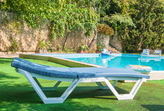Chaise lounge by the pool Stock Photo