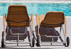 Chaise lounge by the pool. In luxury resort stock photos