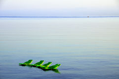 Chaise lounge on the sea. In the summer morning stock images