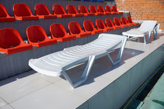 Chaise lounge in the swimming pool. Chaise lounge for fire about tribunes of the swimming pool stock photography