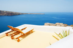 Chaise lounge on the terrace with sea view. Santorini island, Greece stock photo