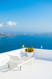 Chaise lounge on the terrace with sea view. Santorini island, Greece stock images