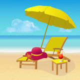 Chaise lounge with umbrella on idyllic tropical sandy beach. Stock Photography