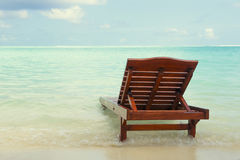 Chaise lounge in the water. On the ocean. landscape royalty free stock photography