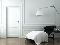 Chaise lounge on white classic wall Stock Images