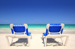 Chaise lounger chairs at beach resort Stock Image