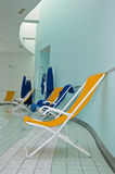 Chaise lounger in pool room Royalty Free Stock Image
