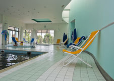 Chaise lounger in pool room Stock Photos