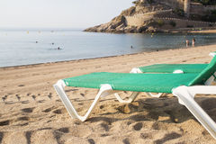 Chaise-Loungers on deserted beach in Tossa De Mar. Spain. Close-up, sunny day stock photography