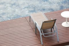 Chaise lounges around swimming pool. Outdoor Chaise lounges around swimming pool royalty free stock images