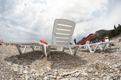 Chaise lounges. On a beach royalty free stock images