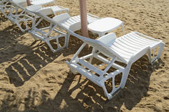Chaise lounges on a beach Royalty Free Stock Image