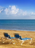 Chaise lounges on a beach.Landscape Stock Photos