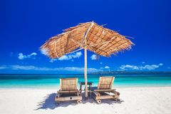 Chaise lounges on beach Stock Images