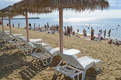 Chaise lounges and beach umbrellas on a beach Royalty Free Stock Photography