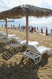 Chaise lounges and beach umbrellas on a beach Stock Photography