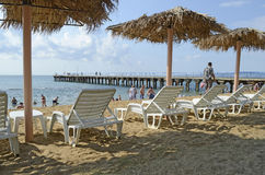 Chaise lounges and beach umbrellas on a beach Stock Images