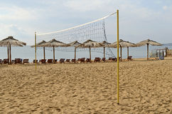 Chaise lounges and beach umbrellas from a reed Stock Photography
