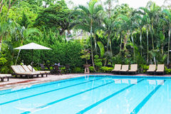 Chaise lounges at pool Stock Photography