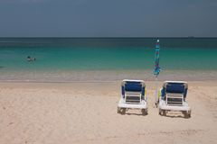 Chaise lounges on sandy beach. St. George`s, Grenada. 08-11-2017 stock photo