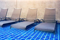Chaise lounges in swimming pool.  royalty free stock image