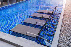 Chaise lounges in swimming pool.  royalty free stock photo