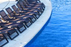 Chaise lounges at the swimming pool in spa resort. Mexico. stock photos