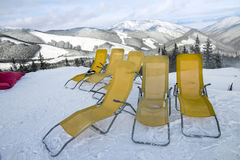 Chaise lounges in winter resort Stock Image