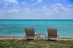 Chaise sur la plage photographie stock