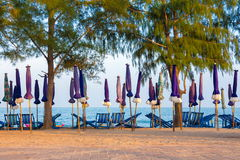 Chaise sur le sable de mer Photos libres de droits