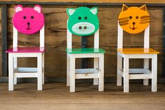 Chaises animales multicolores Photos stock