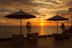 Chaises au coucher du soleil Image libre de droits