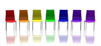 Chaises colorées sur le fond blanc Photos libres de droits
