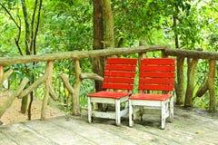 Chaises dans le jardin Images libres de droits